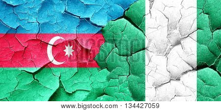 Azerbaijan flag with Nigeria flag on a grunge cracked wall