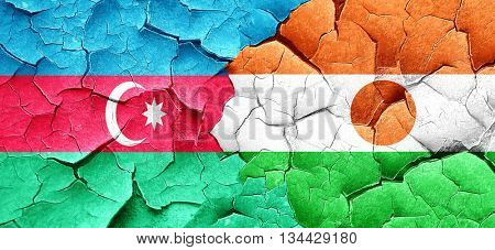 Azerbaijan flag with Niger flag on a grunge cracked wall