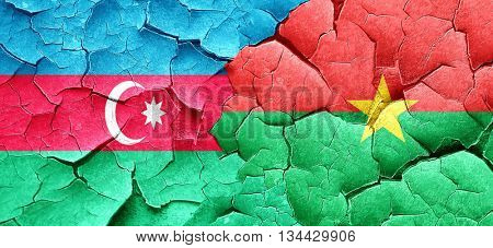 Azerbaijan flag with Burkina Faso flag on a grunge cracked wall