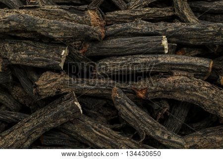 Organic dry True comfrey (Symphytum officinale) roots. Macro close up background texture. Top view.