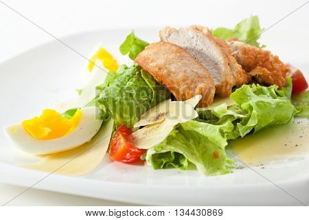 Caesar Salad dressed with Chicken Fillet, Salad Leaf, Croutons, Cherry Tomato, Eggs and Parmesan Cheese