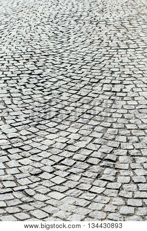 Paving stones road background grey color of textured ground with nobody