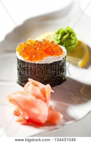 Salmon Roe Gunkan Maki Sushi with Cream Cheese. Garnished with Ginger and Wasabi
