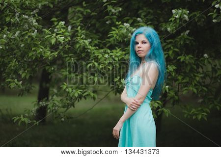 Portrait Of Girl With Blue Hair Outdoors In Spring With Copy Space. Beautiful Stylish Woman. Barbers