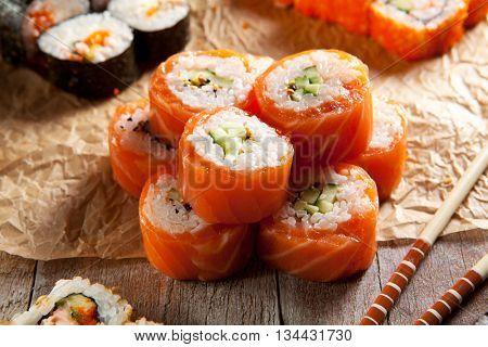 Philadelphia Maki Sushi made of Fresh Raw Salmon, Cream Cheese and Cucumber