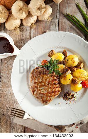 Pork Steak with Potato and Parsley