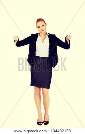 Unhappy businesswoman with thumbs down gesture