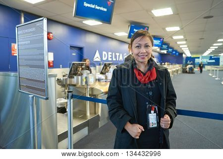 NEW YORK - MARCH 14, 2016: stewardess in JFK airport. John F. Kennedy International Airport is a major international airport located in the Queens borough of New York City, United States