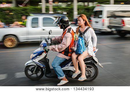 BANGKOK THAILAND - MAY 2 2016 : orange jacket motorbike taxi near MRT Huay Kwang in Bangkok