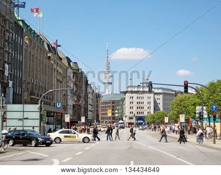 Hamburg Germany - May 22 2008: View of famous street Jungfernstieg towards tv tower Heinrich-Hertz-Turm. Shopping mall Alsterhaus on the left.