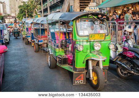 BANGKOK THAILAND - MAY 2 2016 : green thailand rickshaw tuk tuk taxi service at Huay Kwang market