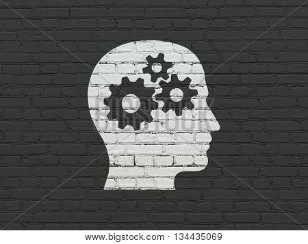 Advertising concept: Painted white Head With Gears icon on Black Brick wall background