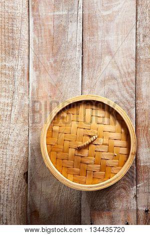 Bamboo Basket Steamer on Wood Background