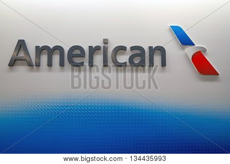 CHICAGO - MARCH 22, 2016: American Airlines logo on the wall at Chicago O'Hare International Airport. American Airlines, Inc. is a major American airline headquartered in Fort Worth, Texas.