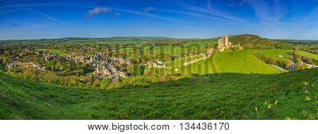 Panorama of Corfe castle village and ruins of the castle in County Dorset, UK