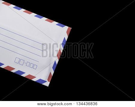 white envelope isolated on black backgroundwhite red and blue envelope