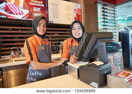 KUALA LUMPUR, MALAYSIA - MAY 09, 2016: Staff members of McCafe. McCafe is a coffee house style food and drink chain, owned by McDonald's.