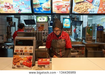 KUALA LUMPUR, MALAYSIA - MAY 09, 2016: interior of McDonald's. McDonald's is the world's largest chain of hamburger fast food restaurants.