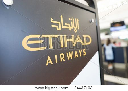 HONG KONG - MAY 12, 2016: design of Etihad check in counters at Terminal 1 of Hong Kong Airport. Etihad Airways is a flag carrier and the second-largest airline of the United Arab Emirates.