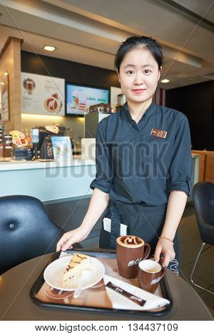 SHENZHEN, CHINA - MAY 06, 2016: Staff members of McCafe. McCafe is a coffee house style food and drink chain, owned by McDonald's.