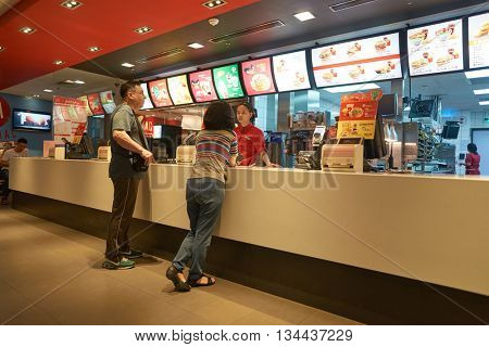 SHENZHEN, CHINA - MAY 07, 2016: inside of McDonald's restaurant. McDonald's is the world's largest chain of hamburger fast food restaurants, founded in the United States.