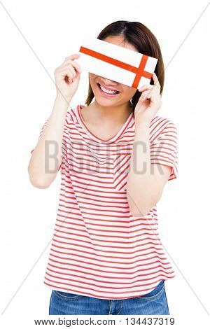 Happy young woman holding an envelope on white background