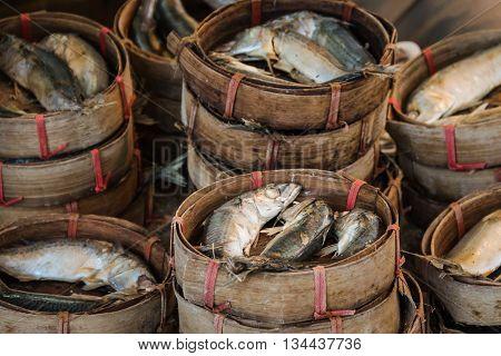 fresh mackerel fish in wood basket sell in market in bangkok