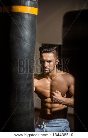 Muscular Man With Punching Bag