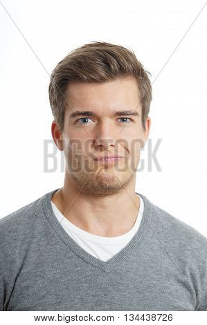 young man is making a funny face. isolated on white background