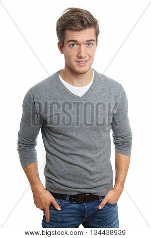 young man with hands in pockets. isolated on white background