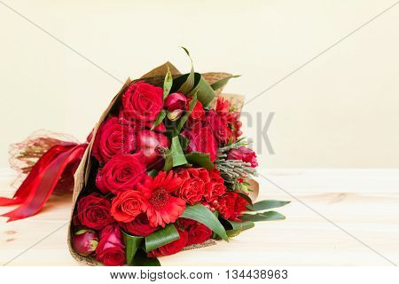 Red Bouquet Of Roses, Gerberas, Peonies, Pomegranates With Copyspace. Love And Passion Symbol. Anniv