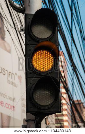 BANGKOK THAILAND - MAY 2 2016 : yellow orange traffic light signal in Bangkok