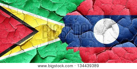 Guyana flag with Laos flag on a grunge cracked wall