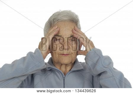 Senior woman with head ache on white background