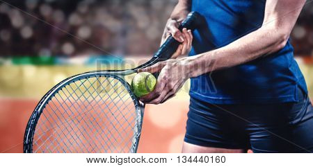Tennis player holding a racquet ready to serve against composite image of tennis ground with supporter