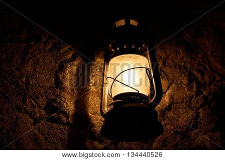 mystery old designed lamp inside a cave