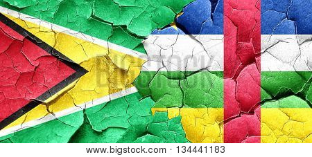 Guyana flag with Central African Republic flag on a grunge crack