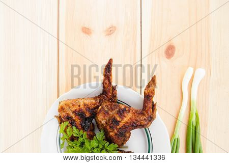 Chicken Wings On Plate And Onion On Light Wooden Background With Copyspace. Cuisine Background. East