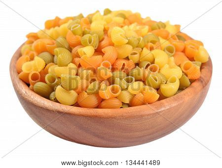 Colored Uncooked Italian Pasta Pipe Rigate In A Wooden Bowl On A White