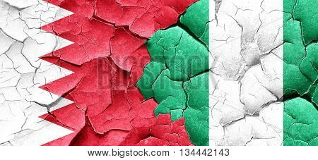 Bahrain flag with Nigeria flag on a grunge cracked wall