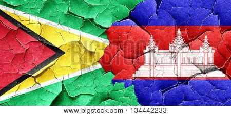 Guyana flag with Cambodia flag on a grunge cracked wall