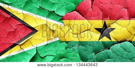 Guyana flag with Ghana flag on a grunge cracked wall