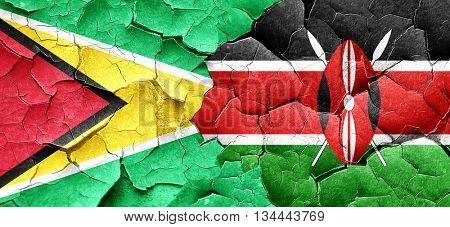 Guyana flag with Kenya flag on a grunge cracked wall