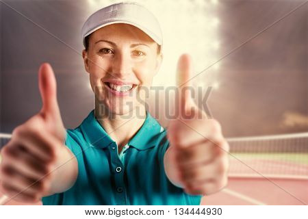 Sportswoman posing on black background against digitally generated image of tennis court and spotlight