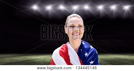 Portrait of american sportswoman is smiling against rugby stadium