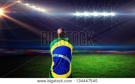 Rear view of brazilian sportsman against rugby stadium