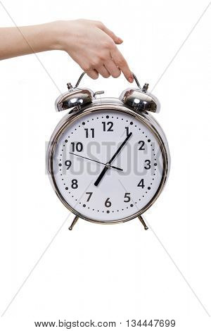 Hand holding alarm clock isolated on white