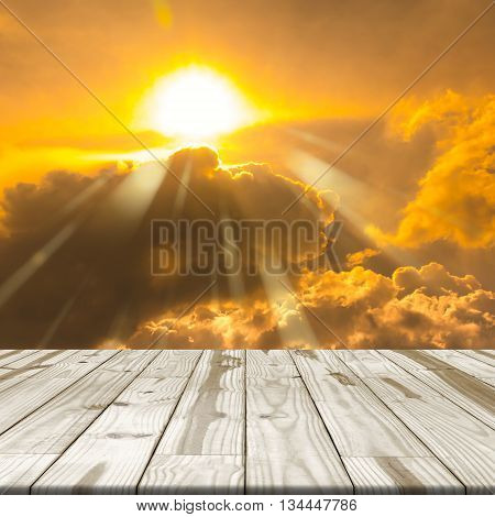 Wood table top on golden sky and Sunshine
