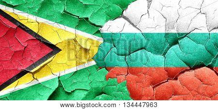 Guyana flag with Bulgaria flag on a grunge cracked wall