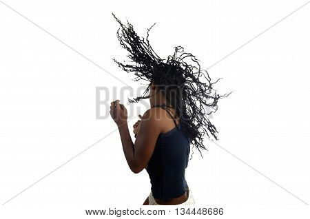 Young black teenager dancing on white background